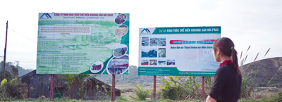 A billboard containing information about the Nui Phao Project and its benefits.