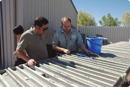 Examining core at Chinalco Yunnan Copper Resources' yard in Mt Isa, northwest Queensland.