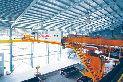 Moly-Cop Indonesia's 15t Konecranes SMARTON 'crane with a brain' with magnetic lifter, used for lifting forged steel ball fine grinding media for mineral ores and other particulate materials.
